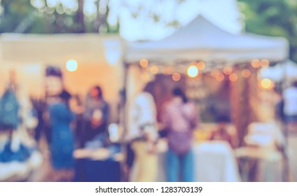 Vintage tone abstract blur image of Street Day market in garden with bokeh for background usage .