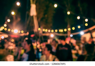 Vintage tone abstract blur image of  Street Night Market in garden with bokeh for background usage.