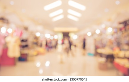 Vintage tone Abstract blur image of  Shopping mall with bokeh for background usage .