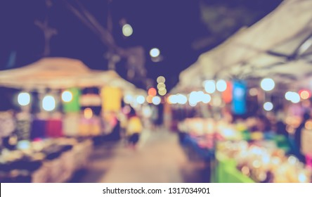 Vintage tone  abstract blur image of Street night market with bokeh for background usage .