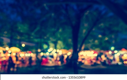 Vintage tone abstract blur image of Street Night Market in garden with bokeh for background usage .