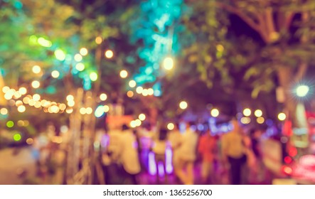 Vintage tone abstract blur image of Night market in garden with light bokeh for background usage .