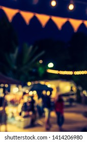 Vintage tone abstract blur image of Street Night Festival in garden with bokeh for background usage .