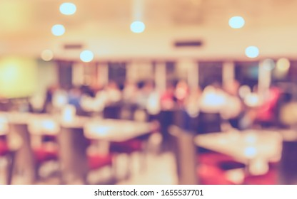 Vintage tone abstract blur image of Restaurant or Cafe with bokeh for background usage .