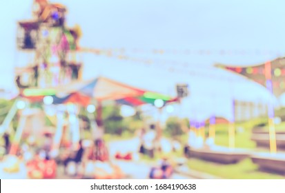 Vintage tone abstract blur image of  Theme park on day time with bokeh for background usage .
