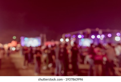 Vintage tone abstract blur image of Outdoor party in night time with light bokeh for background usage .