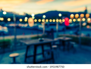 Vintage tone abstract blur image of  Outdoor Cafe or Restaurant with bokeh for background usage .