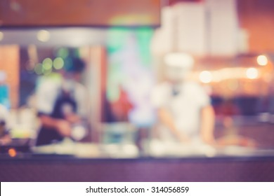Vintage tone of Abstract blur of Pizza or italian restaurant with chef in the background