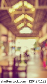 Vintage tone abstract blurred image  of  Indoor day market  with bokeh for background usage.