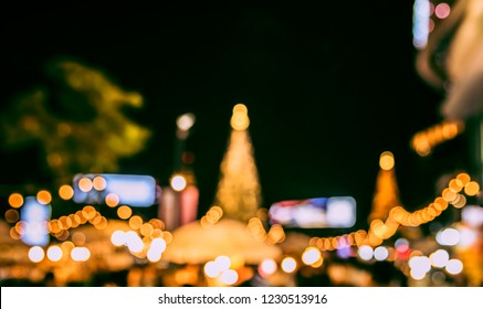 Vintage tone Abstract Blurred image of Night Festival on street  with light bokeh for background usage.