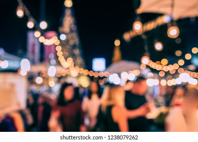 Vintage tone Abstract Blurred image of Night Festival in Christmas theme with light bokeh for background usage.