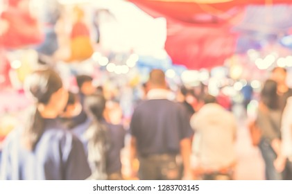Vintage tone Abstract Blurred image of People walking at Day market on street  with bokeh for background usage .