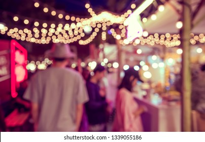 Vintage tone abstract blurred image of Street  night festival with light bokeh  for background usage.