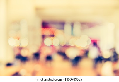 Vintage tone abstract blurred image of People walking at Indoor day market with bokeh  for background usage.