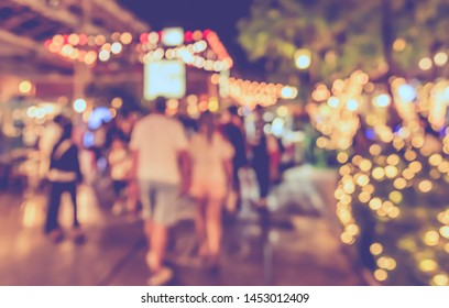 Vintage tone abstract blurred image of Night market on street with bokeh  for background usage.