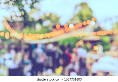 Vintage tone abstract blurred image Street  day market in garden with bokeh  for background usage.