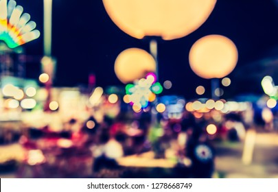 Vintage tone Abstract Blurred Night festival on street with bokeh for background usage.