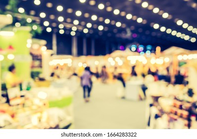 Vintage tone Abstract Blurred Shopping mall or Exhibition hall with bokeh for background usage.