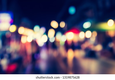 Vintage tone Abstract Blurred Street night market with bokeh for background usage.