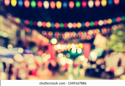 Vintage tone Abstract Blurred Street night festival with bokeh for background usage.