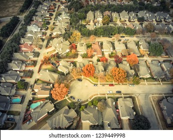 Vintage tone aerial view residential neighborhood in Dallas, Texas suburb of Irving, Texas, USA. Tightly packaged single-family homes with cul-de-sac (dead end) street colorful fall foliage leaves