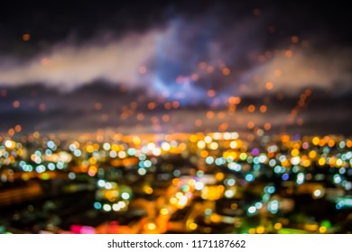 vintage tone blur image of city lights and fireworks during new year festival cerebration with bokeh for background usage.