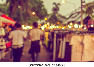 vintage tone blur image of night market on street with bokeh for background usage.