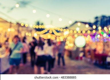 vintage tone blur image of night festival on street blurred background with bokeh .