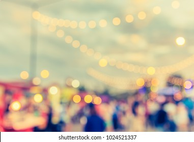 vintage tone blur image of people in festival on street with bokeh for background usage .