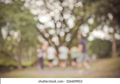Vintage tone Blur image of people activities in park with bokeh on day time for background usage.