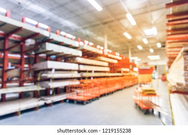 Vintage tone blurred abstract wide selection of pressure treated lumber, studs, wood trim with row of flatbed carts. Defocused lumber and composites department of hardware store in America