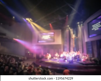 Vintage tone blurred congregation group of people assembled for live religious worship music in Texas, America. Crowd at music concert light background illumination