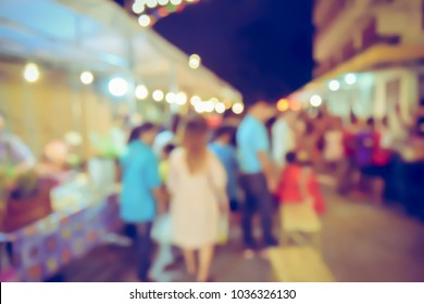 Vintage tone blurred defocused night of walking street festival in thailand bokeh background