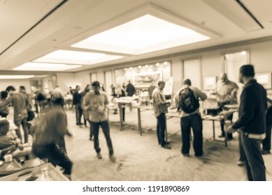 Vintage tone blurred diverse group of people at continental breakfast of workshop event in suburban Dallas, Texas, USA. Defocused catering food self-service meal table at hotel hall banquet