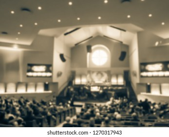 Vintage tone blurred motion Christmas Eve service at American Church