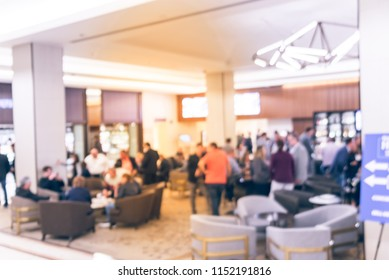 Vintage tone blurred motion people have happy hour, casual business meeting at the lobby of luxury hotel in San Francisco, California, USA. Blurry abstract background industry networking event