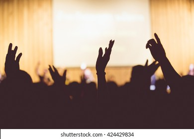 Vintage tone of christian music concert with raised hand