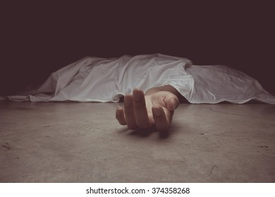 vintage tone of The dead woman's body. Focus on hand