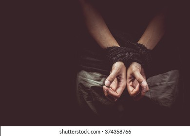 vintage tone of Hands of a victim tied up with rope
