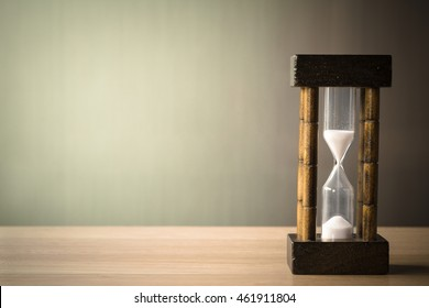 vintage tone of hourglass. passing time in a countdown sandglass with copy space for add text.