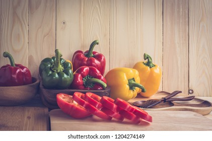 vintage tone image of sweet peppers on wooden table background.