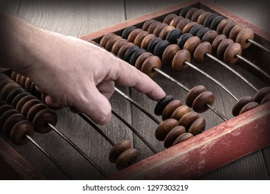 Vintage tone of Man's hands accounting with old abacus .financial concept design.