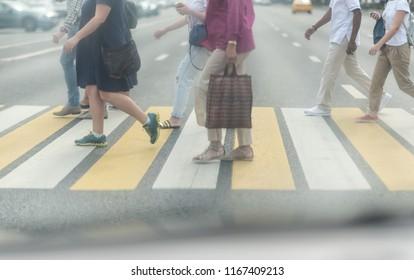 vintage tone of Motion blurred pedestrians crossing street