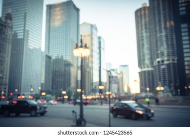 Vintage tone motion blurred river walk at downtown Chicago at sunset. Defocused pedestrian walking and busy cars on traffic with illuminated skylines in background