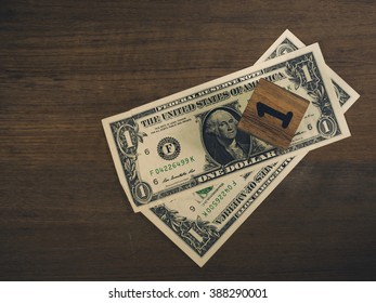 Vintage tone One dollar bills on wooden vintage background