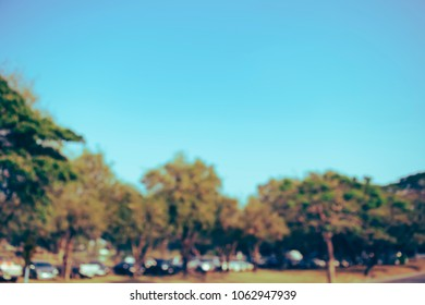 (Vintage tone) Sky trees and car park Blurred defocused abstract Background