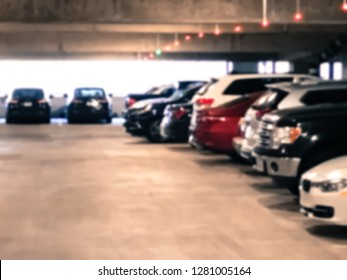 Vintage tone underground parking garage at American airport. Rows of red and green lights hanging over the parking spaces show whether or not a parking spot is open. Smart parking loT guidance system