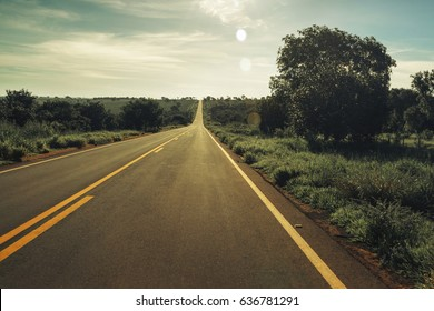 Vintage toned Highway with fields around and no car on the road, Mato Grosso do Sul - Brazil.