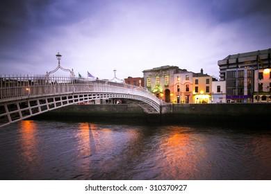 Vintage toned image of historic Ha'penny Bridge over the River Liffey in Dublin Ireland