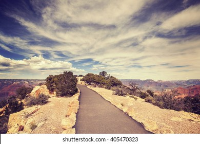 Vintage toned path to the Grand Canyon South Rim viewpoint, USA.